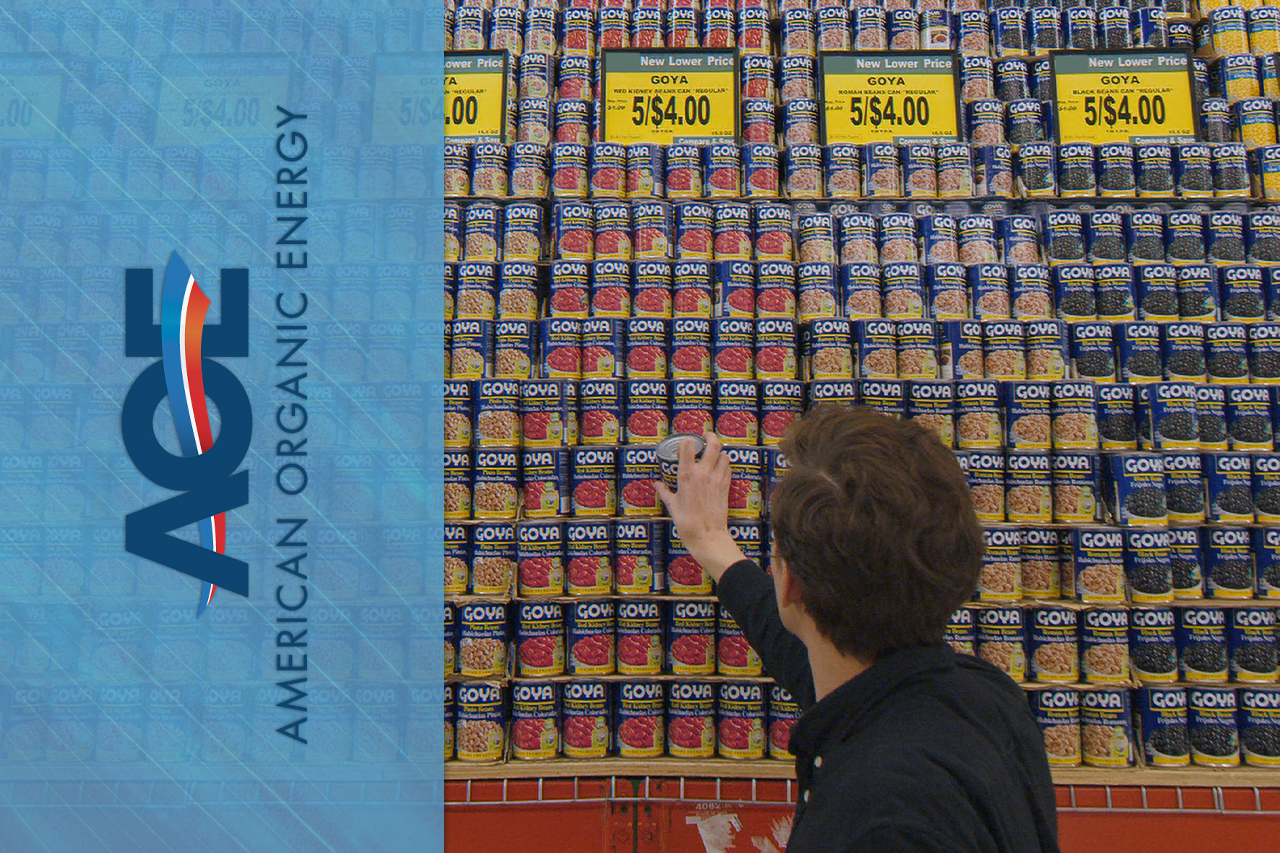 AOE Logo on top of image of man looking at canned products in supermarket