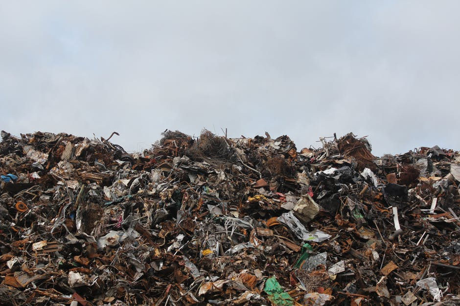 Side view of trash pile in dump